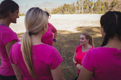 Group of women interacting with each other in the boot camp Stock Photos