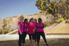 Group of women interacting with each other in the boot camp Royalty Free Stock Images