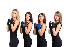 Group of women isolated at white making tae bo Stock Photos