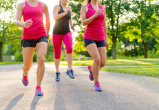 Group of women jogging in nature Stock Photos