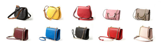 Group of women leather handbag isolated on white background. Collection of color women leather purses and handbag isolated on white background Stock Photo