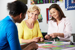 Group Of Women Making Quilt Together Stock Image