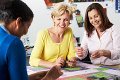 Group Of Women Making Quilt Together Stock Photography