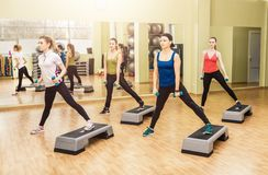 Group of women making step aerobics Stock Image