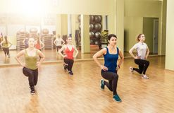 Group of women making step aerobics Stock Photo