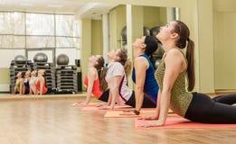 Group of women making step aerobics Stock Photos