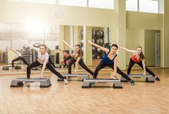 Group of women making step aerobics Royalty Free Stock Photos