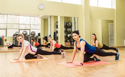 Group of women making step aerobics Royalty Free Stock Images