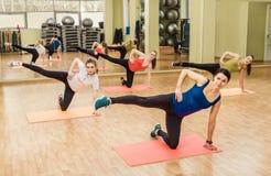 Group of women making step aerobics Royalty Free Stock Photo