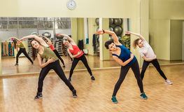 Group of women making step aerobics Stock Images