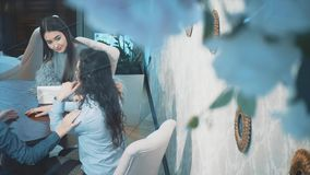 Group of women meeting in cafe. Holidays, tourism, technology and internet - three beautiful girls. Three women enjoying cup of coffee in cafe stock video footage