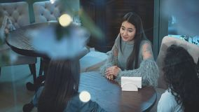 Group of women meeting in cafe. Holidays, tourism, technology and internet - three beautiful girls. Three women enjoying cup of coffee in cafe stock footage