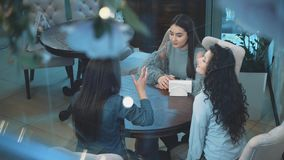 Group of women meeting in cafe. Holidays, tourism, technology and internet - three beautiful girls. Three women enjoying cup of coffee in cafe stock video