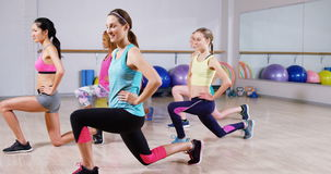 Group of women performing aerobics stock video footage