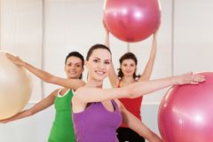 Group of women in pilates class at gym. Stock Photos