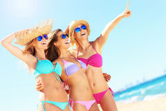 Group of women pointing at something on the beach Royalty Free Stock Photography