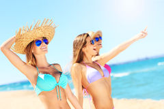 Group of women pointing at something on the beach. A picture of a group of women having fun on the beach Stock Photos