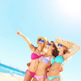 Group of women pointing at something on the beach Royalty Free Stock Image