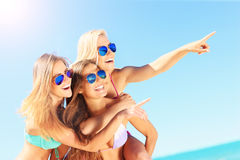 Group of women pointing at something on the beach. A picture of a group of women having fun on the beach Royalty Free Stock Images