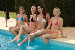 Group of women by the pool Royalty Free Stock Images