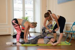 Group of women practicing stretching together Stock Image
