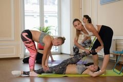 Group of women practicing stretching together Stock Photo