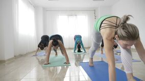 Group of women practicing warrior yoga pose and meditating in slow motion to get over depression -. Group of women practicing warrior yoga pose and meditating in stock footage