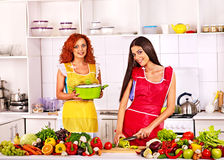 Group women preparing food at kitchen. Stock Photos
