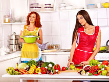 Group women preparing food at kitchen. Royalty Free Stock Image