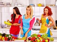 Group women preparing food at kitchen. Royalty Free Stock Images