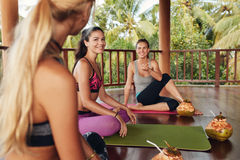Group of women relaxing after yoga class Stock Images