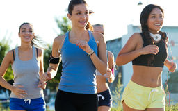 Group of women running in the park. Stock Photo