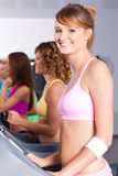 Group of women running on treadmill Stock Photography