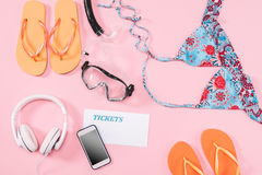 Group of women`s casual outfits with gadgets and snorkeling equipment on pink background Stock Photo