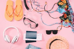 Group of women`s casual outfits with gadgets and snorkeling equipment on pink background Royalty Free Stock Photo