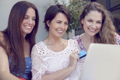 Group of women shopping online Stock Image
