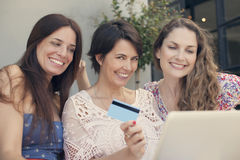 Group of women shopping online Stock Photo