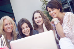 Group of women shopping online Stock Photography