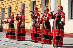The group of women sing a song, wearing traditional Russian clothes in Moscow. Day of Victory, May 9,2014. RUSSIA-MAY 9: The group of women sing a song, wearing Royalty Free Stock Photography