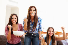 Group Of Women Sitting On Sofa Watching Sport Together Royalty Free Stock Photography