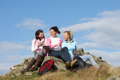 Group Of Women Stopping For Lunch On Countryside Walk Stock Image