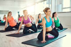 Group of women stretching in a fitness class Royalty Free Stock Image