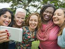 Group Of Women Taking Pictures Concept royalty free stock images