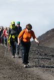 Group of women tourists climbing to volcano Royalty Free Stock Photos