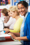 Group Of Women Using Electric Sewing Machines In class Royalty Free Stock Photos
