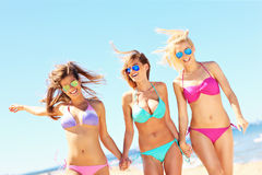 Group of women walking along the beach Royalty Free Stock Photography