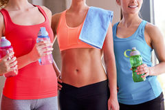 Group of women with water bottles in gym Royalty Free Stock Photos