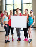 - group of women witn white blank billboard Royalty Free Stock Image