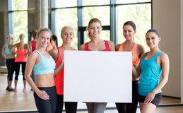 - group of women witn white blank billboard Royalty Free Stock Photo