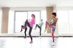 Group of women working out fighting stance in gym Royalty Free Stock Image